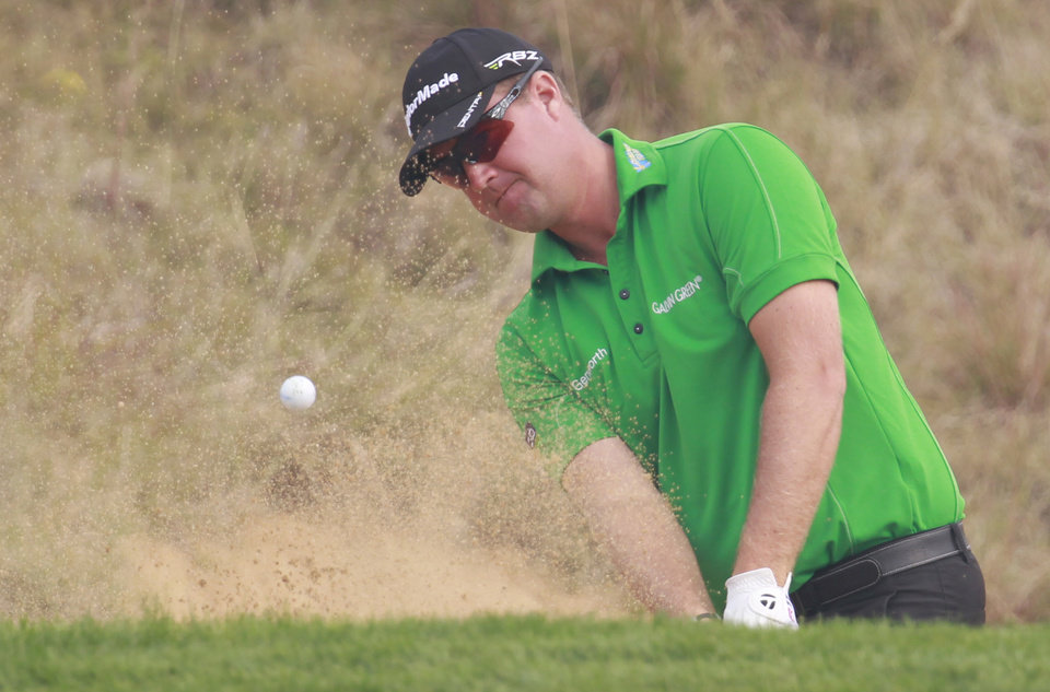 Photo -   Peter Hanson from Sweden hits out of a bunker on the 8th green during the final round of the Masters golf tournament in Shanghai, China on Sunday Oct. 28, 2012. (AP Photo/Eugene Hoshiko)