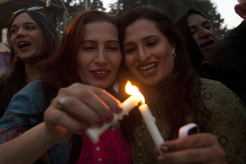 Photo - Pakistani transponders light candles during a demonstration called by civil society group to mark World AIDS Day in Karachi, Pakistan, Thursday, Dec. 1, 2016. (AP Photo/Shakil Adil)