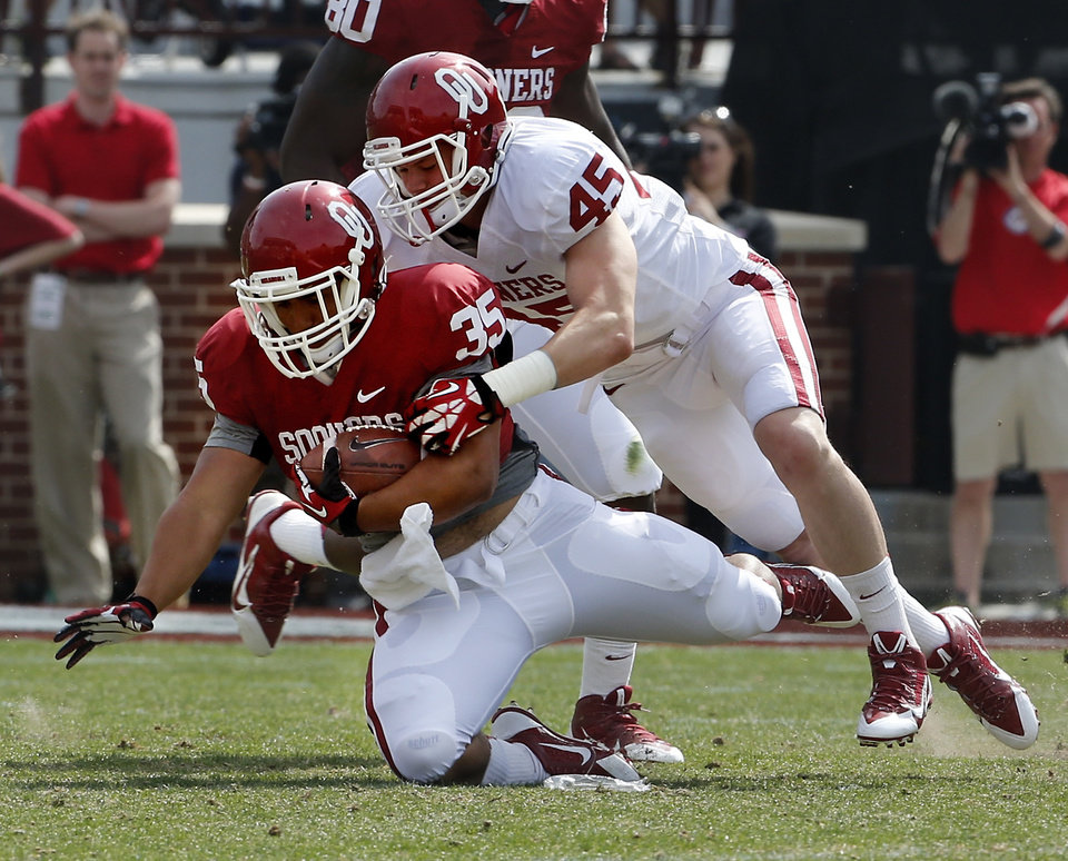 Photo - Leo Luna carries during the Spring College Football Game of the University of Oklahoma Sooners (OU) at Gaylord Family-Oklahoma Memorial Stadium in Norman, Okla., on Saturday, April 12, 2014.  Photo by Steve Sisney, The Oklahoman