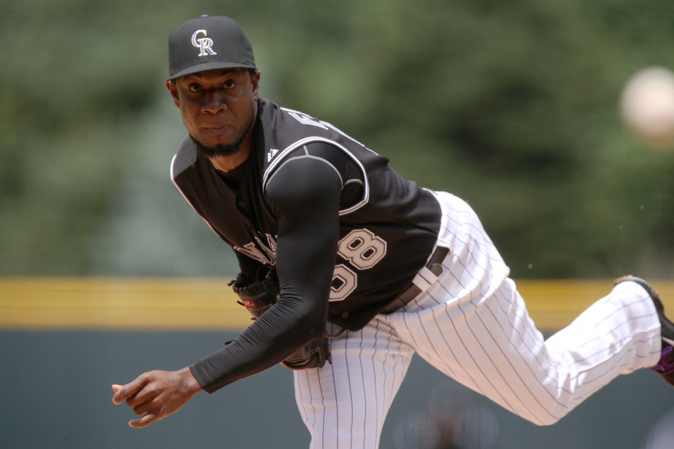 Photo - Colorado Rockies starting pitcher Yohan Flande works against the Chicago Cubs in the first inning of a baseball game in Denver on Thursday, Aug. 7, 2014. (AP Photo/David Zalubowski)