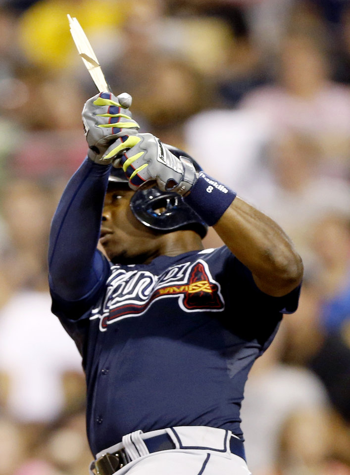Photo - Atlanta Braves' Justin Upton holds the bat after breaking it hitting a single to drive in two runs in the fifth inning of the baseball game against the Pittsburgh Pirates on Tuesday, Aug. 19, 2014, in Pittsburgh. (AP Photo/Keith Srakocic)
