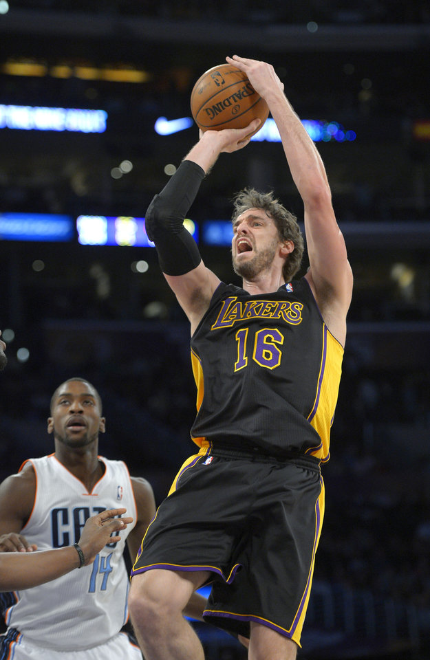 Photo - Los Angeles Lakers center Pau Gasol, right, shoots as Charlotte Bobcats forward Michael Kidd-Gilchrist watches during the first half of an NBA basketball game, Friday, Jan. 31, 2014, in Los Angeles. (AP Photo/Mark J. Terrill)