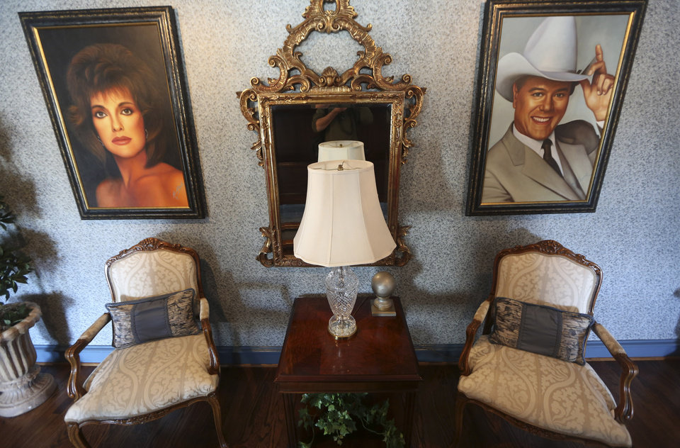 "This photo made Tuesday, Nov. 13, 2012, shows paintings of actors in the Dallas TV show that are displayed in the mansion open to visitors at Southfork Ranch in Parker, Texas. Tourists have been flocking to Southfork Ranch since the early years of the classic series, which ran from 1978 to 1991. And a new ""Dallas"" starting its second season on TNT on Monday and the recent death of the show's star, Larry Hagman, who legendarily played conniving Texas oilman J.R. Ewing, have also spurred fans to visit. (AP Photo/LM Otero)"