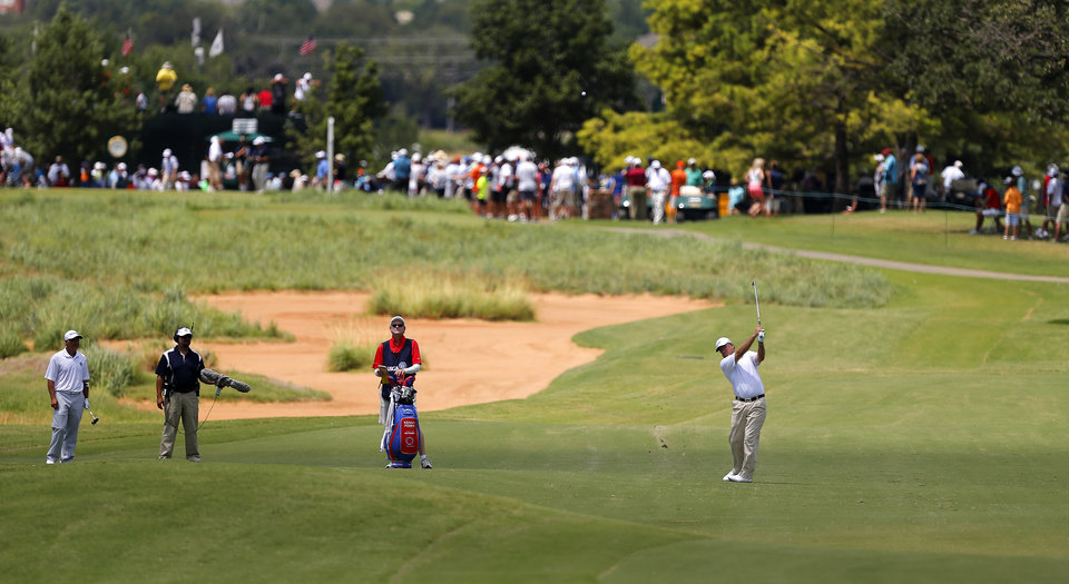 Photo - Kenny Perry hits towards the No. 1 green during the first round of the U.S. Senior Open golf tournament at Oak Tree National in Edmond, Okla., Thursday, July 10, 2014. Photo by Bryan Terry, The Oklahoman