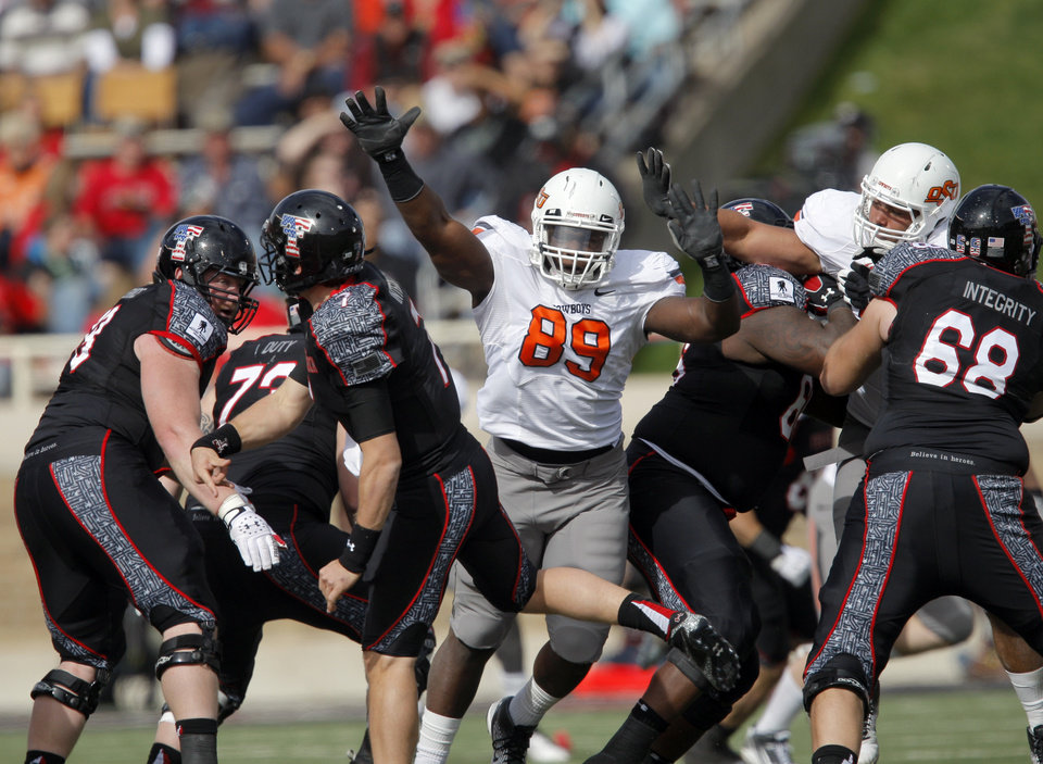 Oklahoma State\'s Nigel Nicholas (89) pressures Texas Tech\'s Seth Doege (7)during a college football game between Texas Tech University (TTU) and Oklahoma State University (OSU) at Jones AT&T Stadium in Lubbock, Texas, Saturday, Nov. 12, 2011. Photo by Sarah Phipps, The Oklahoman ORG XMIT: KOD
