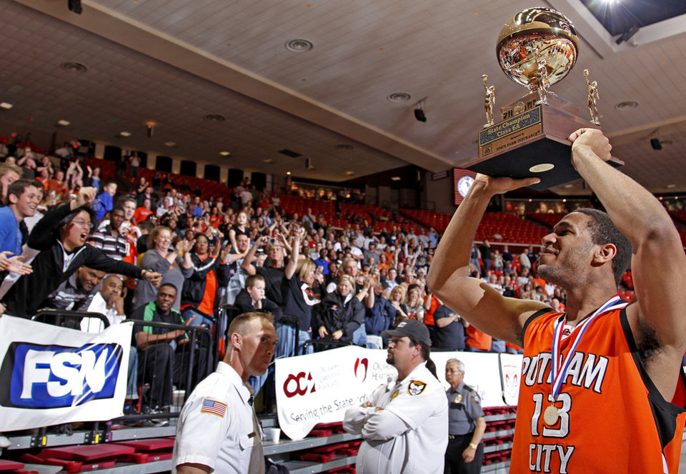 Photo - Putnam City's Xavier Henry celebrates after winning the Class 6A boys championship game between Putnam City and Jenks in the Oklahoma High School Basketball Championships at Lloyd Noble Arena in Norman, Okla., Saturday, March 14, 2009. PHOTO BY BRYAN TERRY, THE OKLAHOMAN