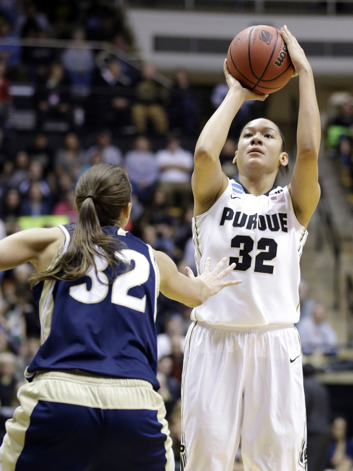 Photo - Purdue forward Whitney Bays, right, shoots over Akron forward Rachel Tecca during the second half of a first-round game in the NCAA women's college basketball tournament in West Lafayette, Ind., Saturday, March 22, 2014. Purdue defeated Akron 84-55. (AP Photo/Michael Conroy)