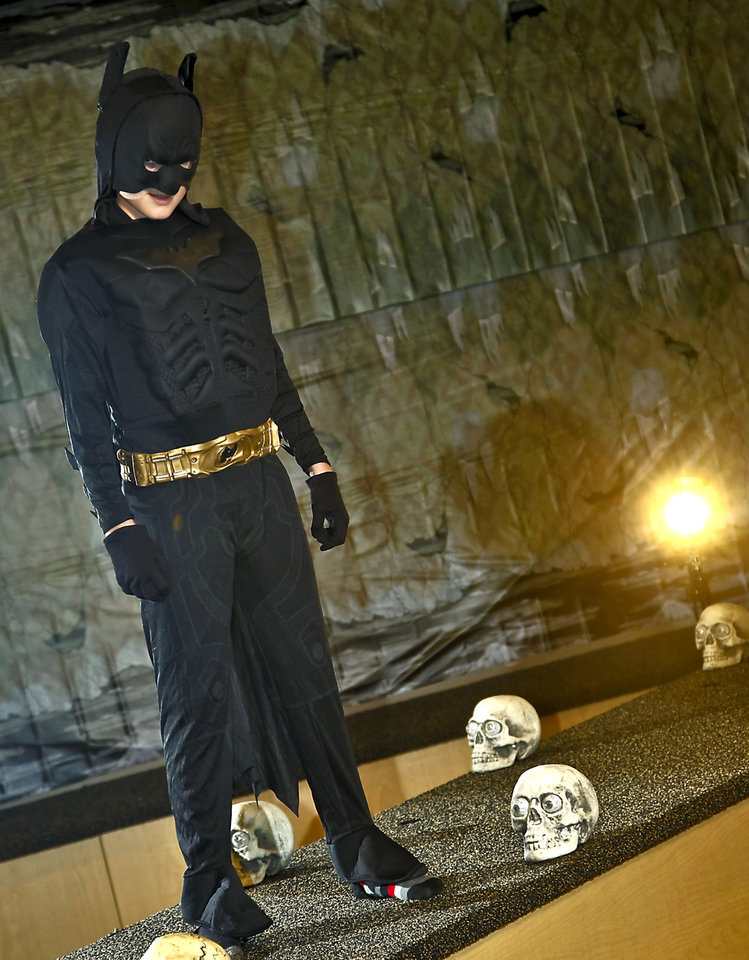 Ryan models a Batman costume sold at Party Galaxy. Photo by Chris Landsberger, The Oklahoman. CHRIS LANDSBERGER