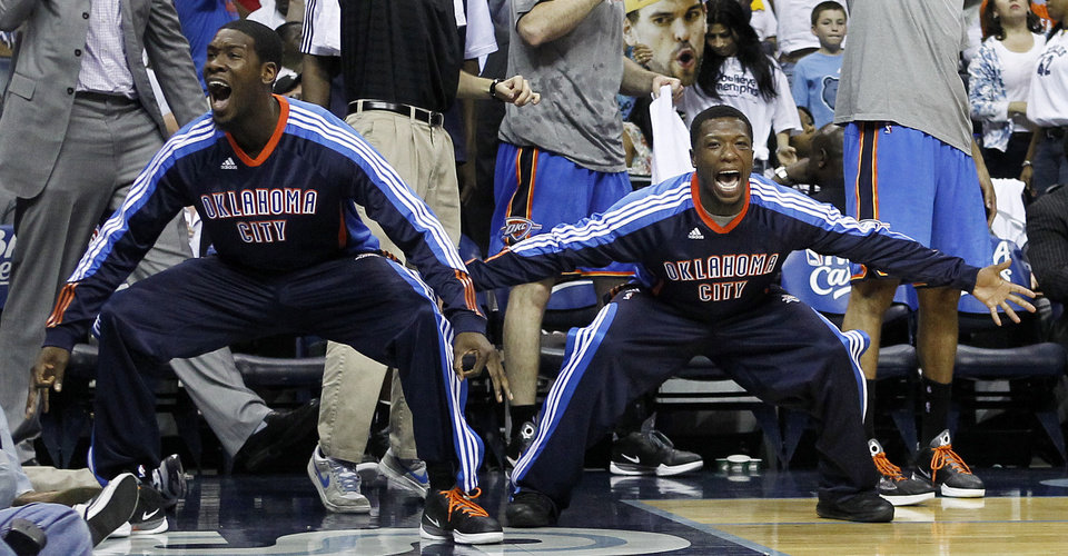 Photo - Oklahoma City Thunder guard Royal Ivey, left, and Nate Robinson, right, celebrate a teammate's score against the Memphis Grizzlies during the first half of Game 6 of a second-round NBA basketball playoff series on Friday, May 13, 2011, in Memphis, Tenn. (AP Photo/Lance Murphey)