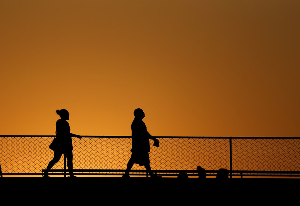 Photo - Fans watch during a high school football game between Douglass and Booker T. Washington at Douglass in Oklahoma City, Friday, September 6, 2013. Photo by Bryan Terry, The Oklahoman