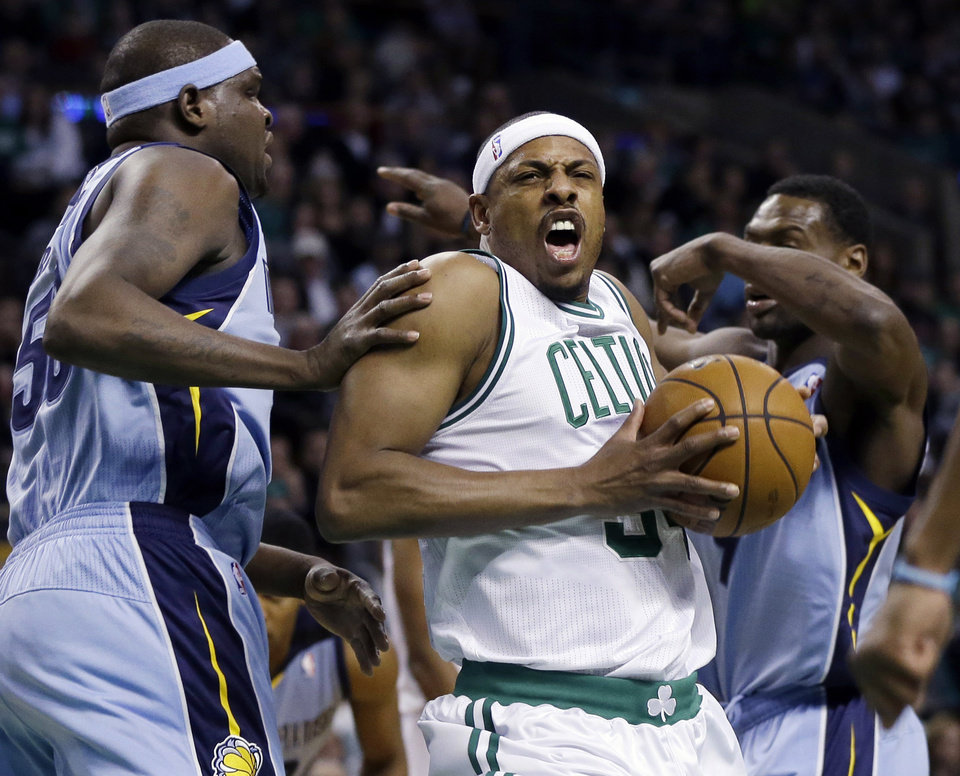 Boston Celtics small forward Paul Pierce, center, drives to the hoop against Memphis Grizzlies power forward Zach Randolph, left, and guard Tony Allen, right, during the first quarter of an NBA basketball game in Boston, Wednesday, Jan. 2, 2013. (AP Photo/Elise Amendola)