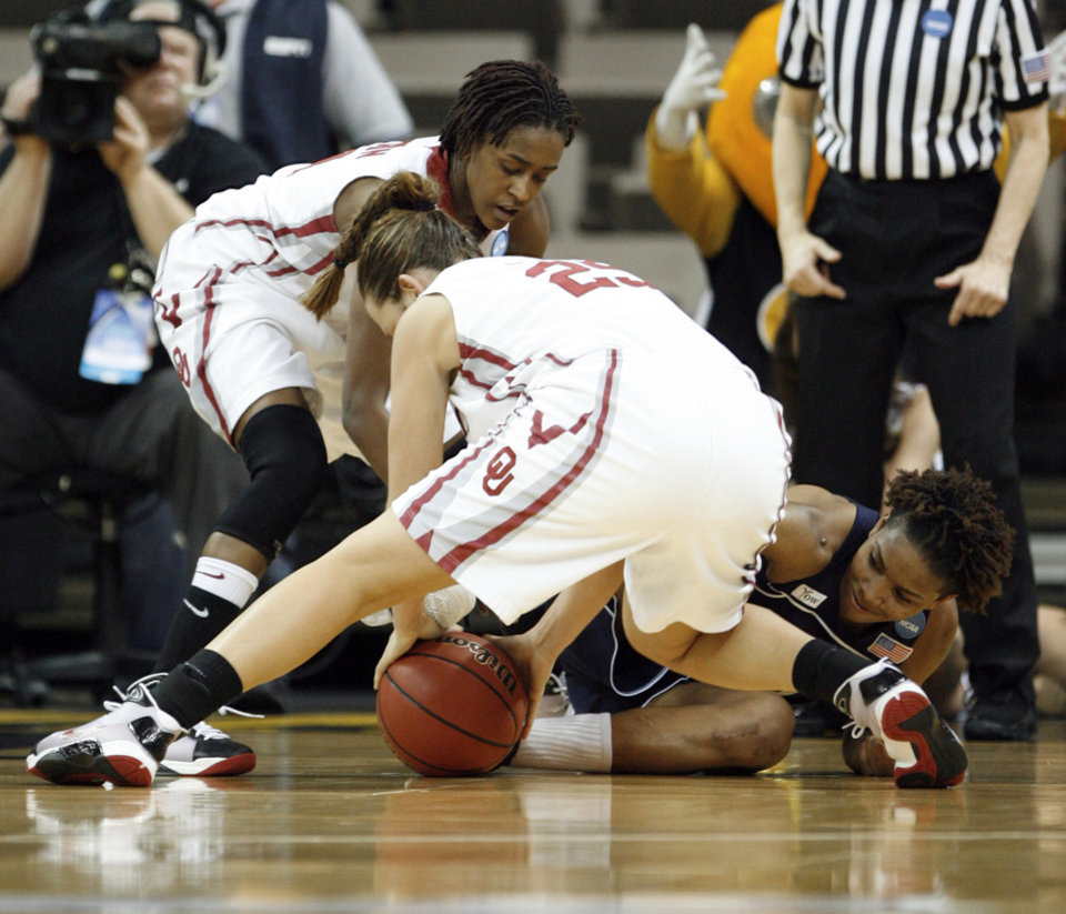Photo - Danielle Robinson (behind) and Whitney Hand (25) tie for the ball with Deja Foster in the second half as the University of Oklahoma (OU) plays Georgia Tech in round two of the 2009 NCAA Division I Women's Basketball Tournament at Carver-Hawkeye Arena at the University of Iowa in Iowa City, IA on Tuesday, March 24, 2009. 