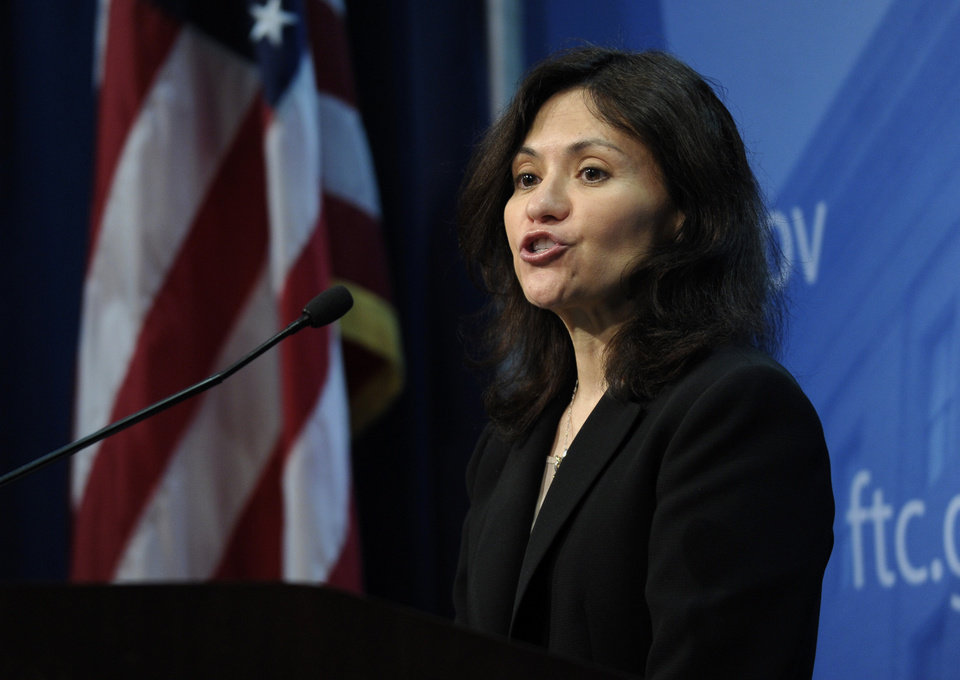 Photo - Federal Trade Commission (FTC) Chair Edith Ramirez speaks at the FTC in Washington, Wednesday, Jan. 15, 2014, where she announced Apple will refund $32.5 million to consumers to settle a federal case involving purchases that kids made without their parents' permission while playing on mobile apps. (AP Photo/Susan Walsh)