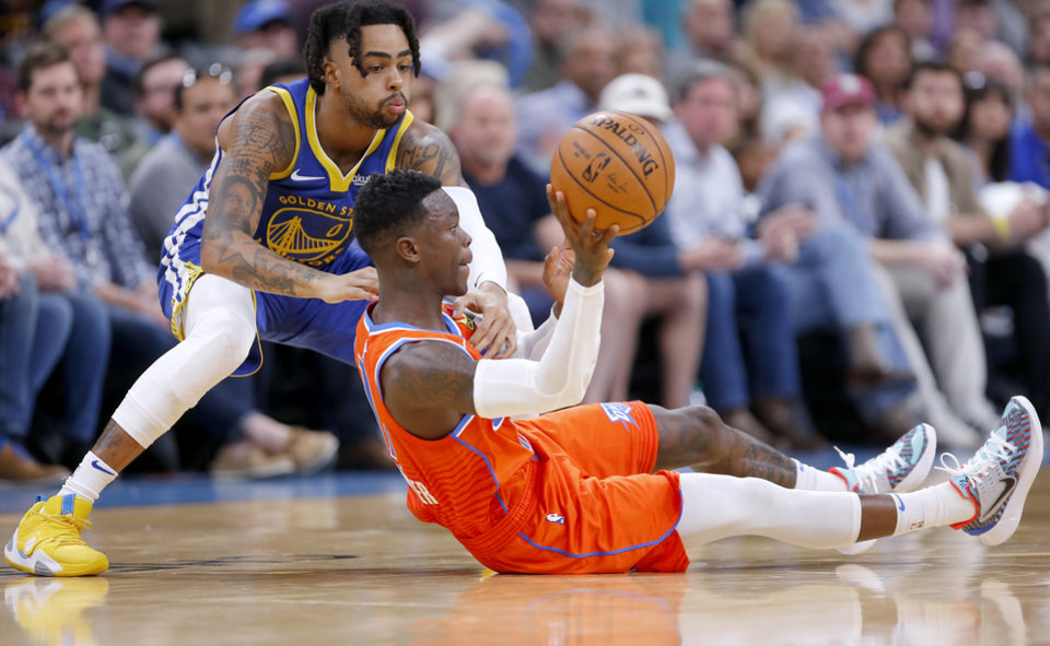 Photo - Oklahoma City's Dennis Schroder (17) gets a loose ball as Golden State's D'Angelo Russell (0) defends during the NBA game between the Oklahoma City Thunder and Golden State Warriors at Chesapeake Energy Arena,  Sunday, Oct. 27, 2019. Thunder won 120-92.[Sarah Phipps/The Oklahoman]