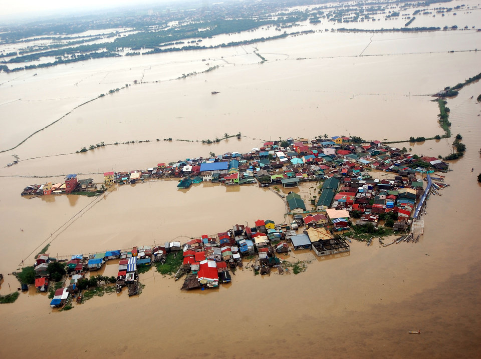 This photo released on Aug. 8, 2012 by the Department of National Defense shows flooded areas in Bulacan province, northern Philippines. Widespread flooding battered a million others and paralyzed the Philippine capital began to ease Wednesday as cleanup and rescue efforts focused on a large number of distressed residents, some still marooned on their roofs. (AP Photo/Department of National Defense) ORG XMIT: XAF801
