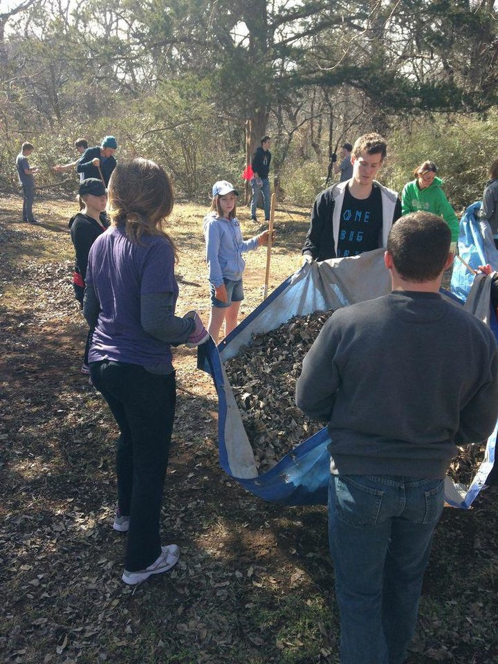 "Members of North Church help round up leaves as part of a ""Love OKC Week"" beautification project at Shiloh Camp in northwest Oklahoma City. Photo provided <strong></strong>"