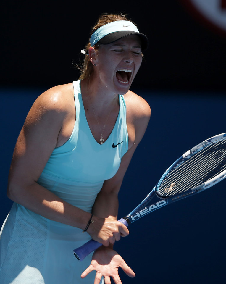 Photo - Maria Sharapova of Russia reacts during her second round match against Karin Knapp of Italy at the Australian Open tennis championship in Melbourne, Australia, Thursday, Jan. 16, 2014.(AP Photo/Aaron Favila)