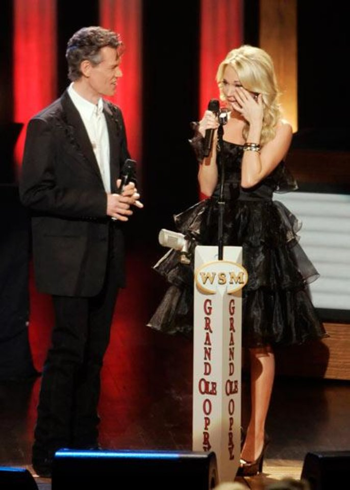 Randy Travis and Carrie Underwood (Associated Press file photo)