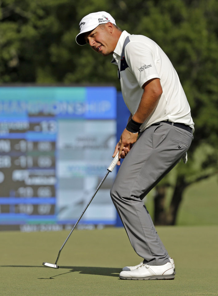 Photo - Freddie Jacobson, of Sweden, reacts as he misses a birdie putt on the 18th hole during the third round of the Wyndham Championship golf tournament in Greensboro, N.C., Saturday, Aug. 16, 2014. (AP Photo/Chuck Burton)