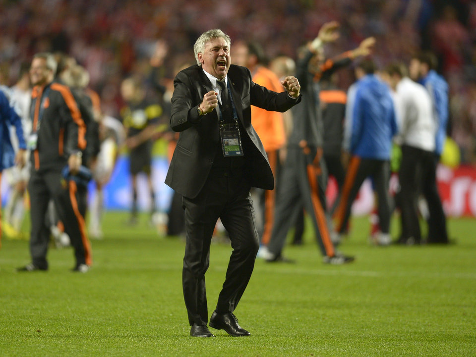 Photo - Real's coach Carlo Ancelotti celebrates at the end of the Champions League final soccer match between Atletico Madrid and Real Madrid, at the Luz stadium, in Lisbon, Portugal, Saturday, May 24, 2014. (AP Photo/Manu Fernandez)