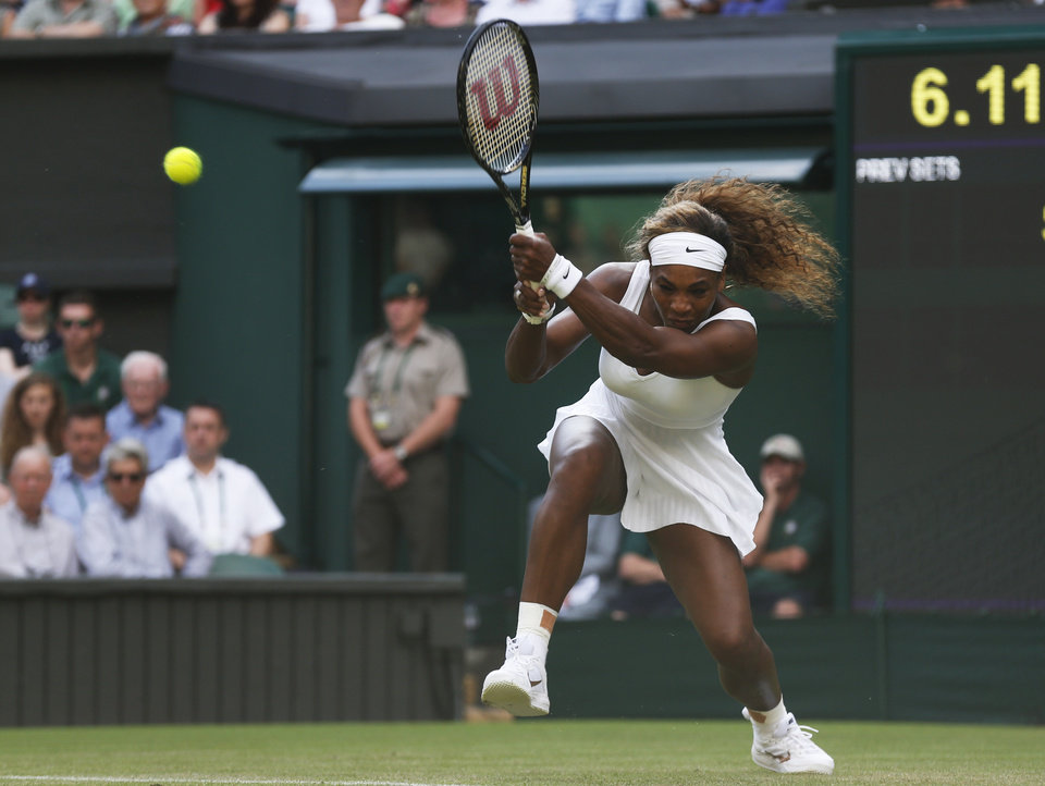 Photo - Serena Williams of U.S. plays a return to Anna Tatishvili of U.S. during their first round match at the All England Lawn Tennis Championships in Wimbledon, London, Tuesday, June 24, 2014. (AP Photo/Sang Tan)