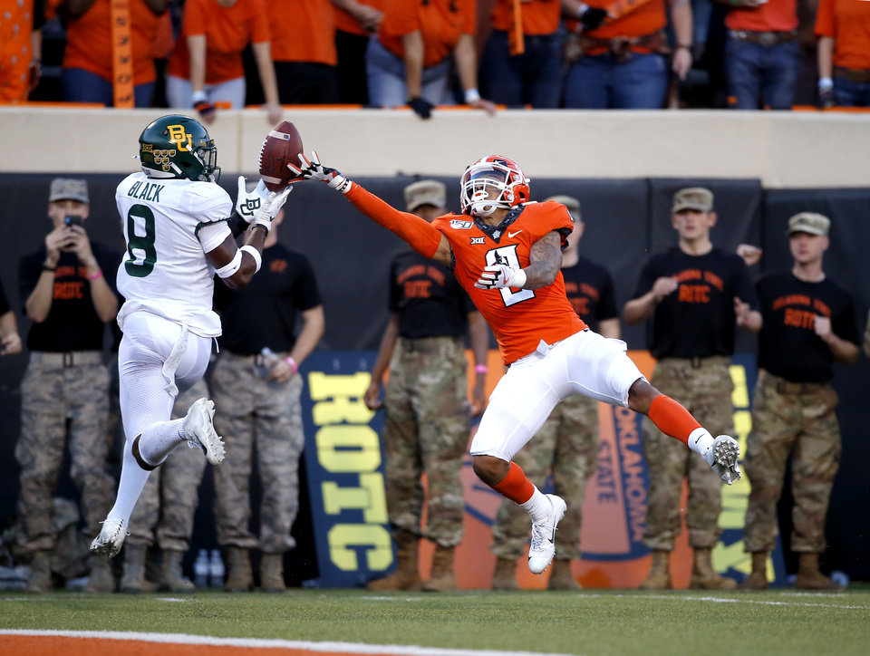 Photo - Baylor's James Lockhart (9) breaks up a pass intended for Oklahoma State's Tylan Wallace (2) in the fourth quarter during the college football game between Oklahoma State University and Baylor at Boone Pickens Stadium in Stillwater, Okla., Saturday, Oct. 19, 2019. Baylor won 45-27. [Sarah Phipps/The Oklahoman]
