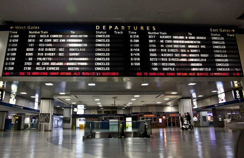 A timetable board displays continued cancellations at Penn Station as MTA resumed limited service on Thursday, Nov. 1, 2012, in New York. The decision to reopen undamaged parts of the nation�s largest transit system came as the region struggles to restore other basic services to recover from a storm that ravaged the East Coast, killing more than 70 people and leaving millions powerless. (AP Photo/CX Matiash)