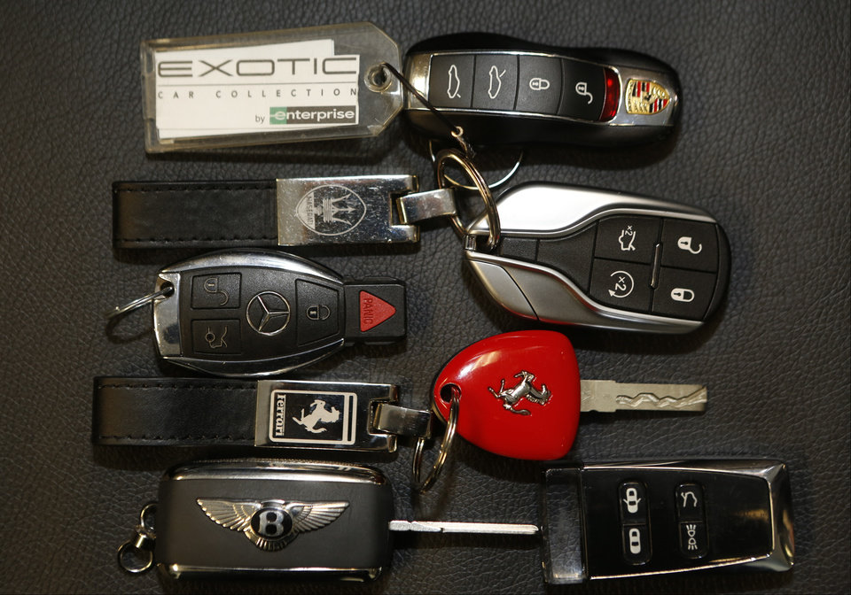 Photo - In this Wednesday, March, 26, 2014 photo, luxury car keys for Porsche, Maserati, Jaguar, Mercedes-Benz, Ferrari, Bentley Continental, and Aston Martin are displayed at the Enterprise Exotic Car Collection showroom near Los Angeles International Airport. (AP Photo/Damian Dovarganes)