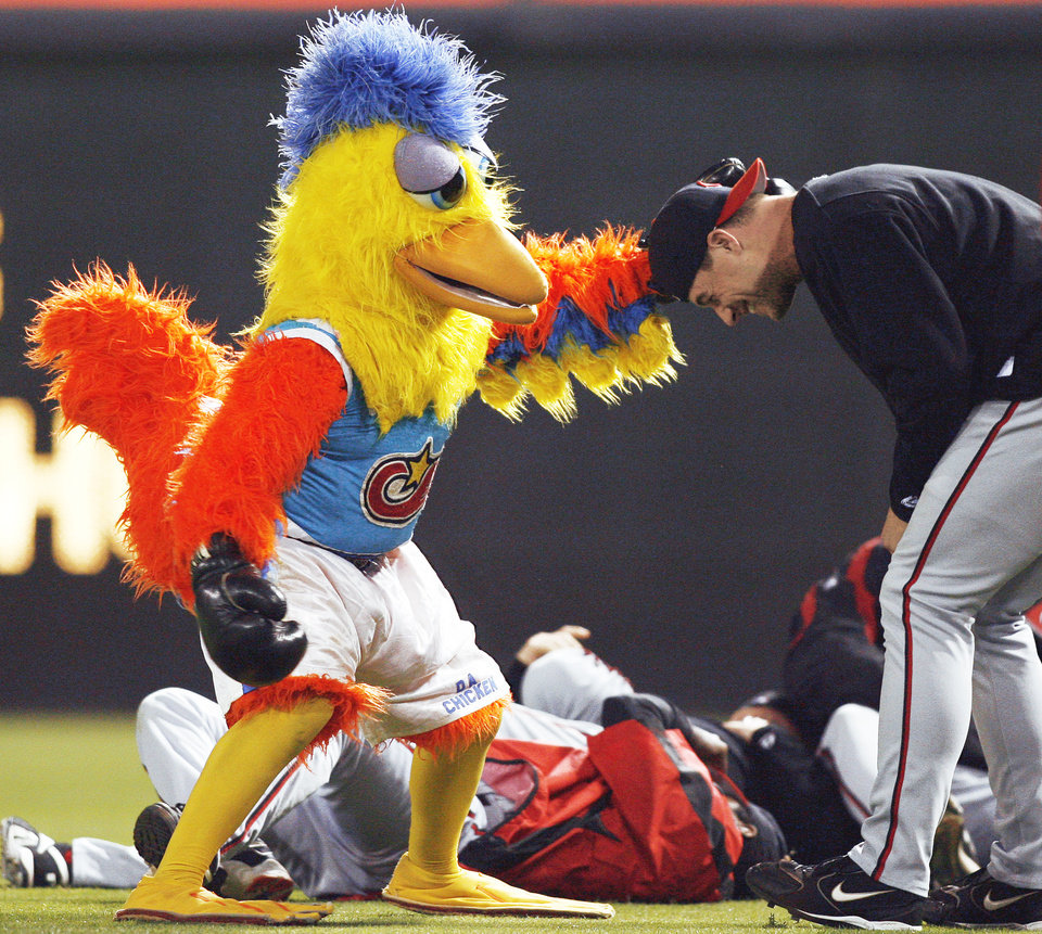 Photo - The Famous Chicken Raymond and Ted Giannoulas turned the Famous Chicken, known for his pranks, into a ballpark staple. AP Photo
