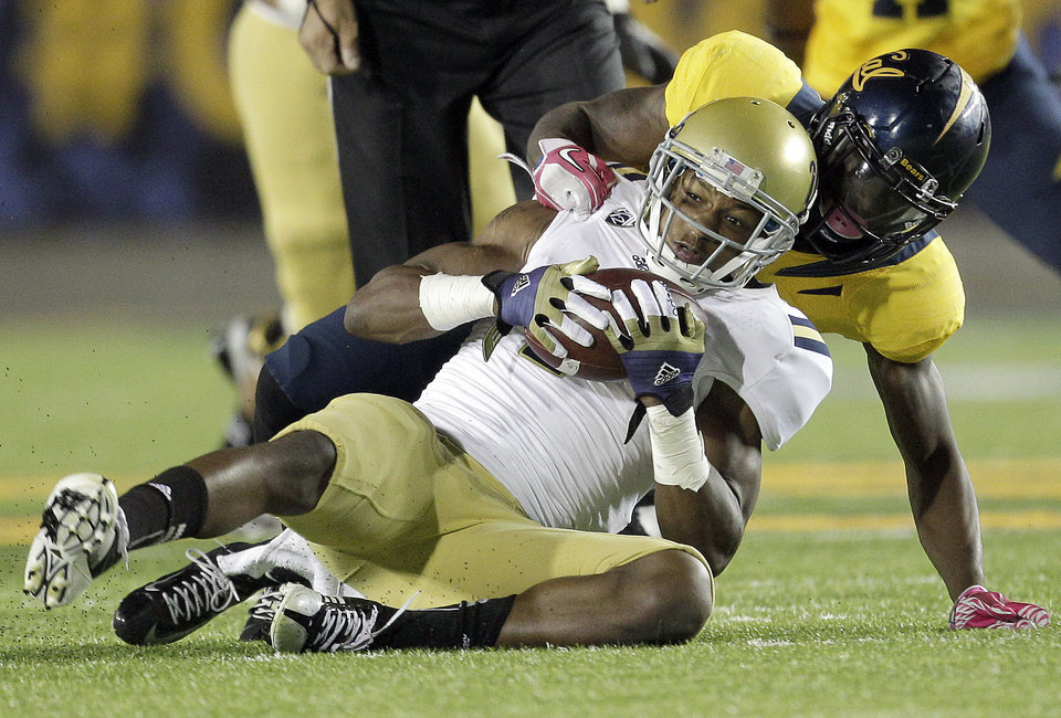 UCLA wide receiver Shaquelle Evans (1) catches a pass against California defensive back Michael Lowe (5) during the second half of an NCAA college football game in Berkeley, Calif., Saturday, Oct. 6, 2012. California won 43-17. (AP Photo/Tony Avelar)