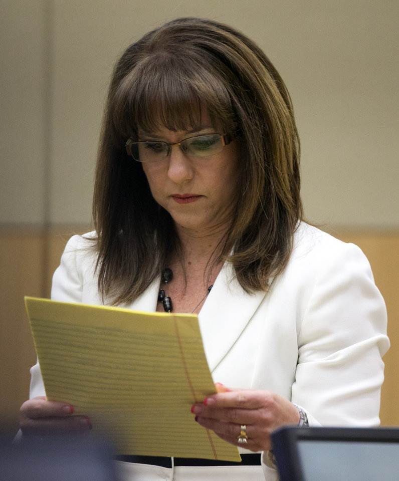 Defense attorney Jennifer Wilmott looks at her notes as she cross examines Dr. Janeen DeMarte, an expert witness for the prosecution, during the Jodi Arias trial at Maricopa County Superior Court in Phoenix on Wednesday, April 17, 2013.   Arias is on trial for the killing of her boyfriend, Travis Alexander in 2008.  Arias claims self-defense but faces a potential death sentence if convicted of first-degree murder.  (AP Photo/The Arizona Republic, David Wallace, Pool)