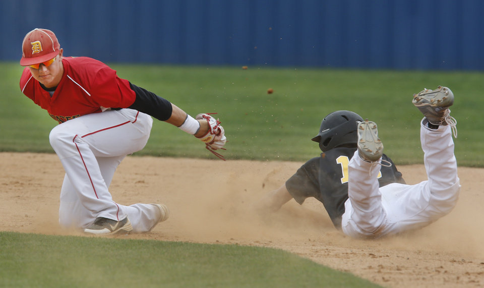 Alva's Riley Hess steals 2nd base as Dale's Taylor Smith tries to make the tag during the Class 2A state tournament at Palmer Field in Oklahoma City , Thursday May 9, 2013. Photo By Steve Gooch, The Oklahoman
