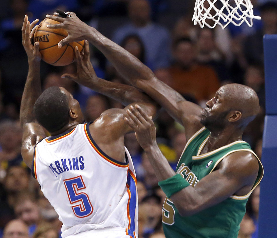 Oklahoma City\'s Kendrick Perkins (5) shoots as Boston\'s Kevin Garnett (5) defends during the NBA game between the Oklahoma City Thunder and the Boston Celtics at the Chesapeake Energy Arena in Oklahoma City, Sunday, March 10, 2013. Photo by Sarah Phipps, The Oklahoman