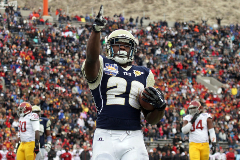 Photo - Georgia Tech running back David Sims celebrates his touchdown against Southern California during the first half of the Sun Bowl NCAA college football game, Monday, Dec. 31, 2012, in El Paso, Texas. (AP Photo/Mark Lambie)