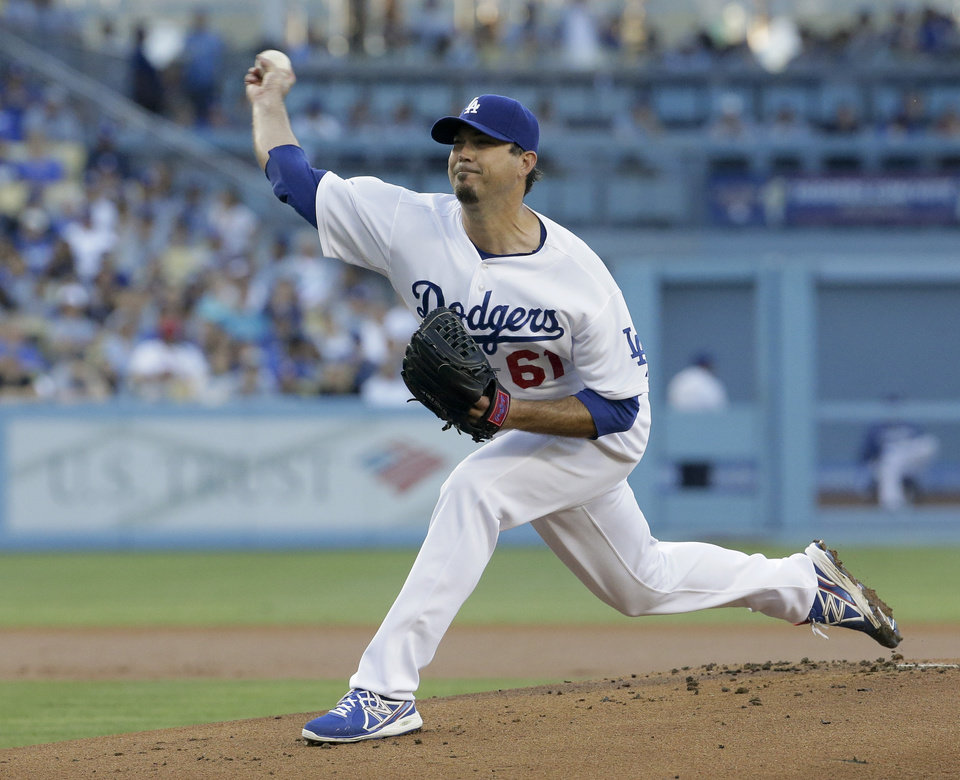 Photo - Los Angeles Dodgers starting pitcher Josh Beckett throws to the Cleveland Indians during the first inning of a baseball game in Los Angeles, Tuesday, July 1, 2014. (AP Photo/Chris Carlson)