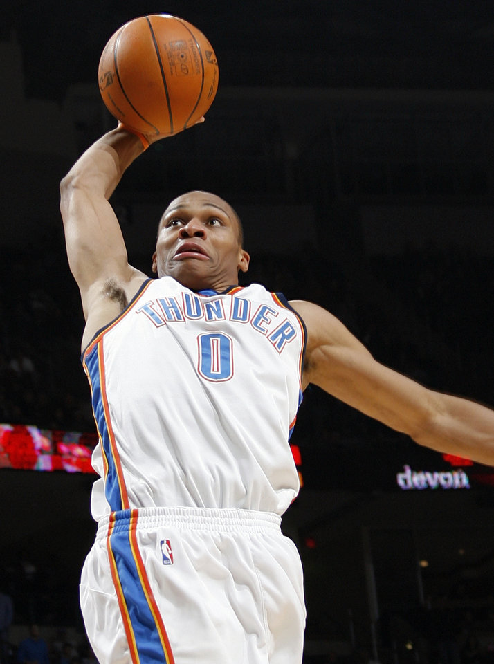 Photo - ALTERNATE CROP: Russell Westbrook (0) of Oklahoma City dunks the ball during the NBA basketball game between the Dallas Mavericks and the Oklahoma City Thunder at the Ford Center in Oklahoma City, Tuesday, Feb. 16, 2010. Photo by Nate Billings, The Oklahoman ORG XMIT: KOD