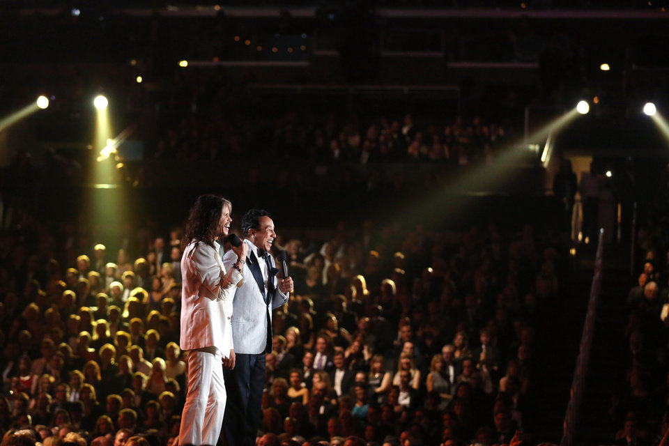 Photo - Presenters Steven Tyler, left, and Smokey Robinson present the award for record of the year at the 56th annual Grammy Awards at Staples Center on Sunday, Jan. 26, 2014, in Los Angeles. (Photo by Matt Sayles/Invision/AP)