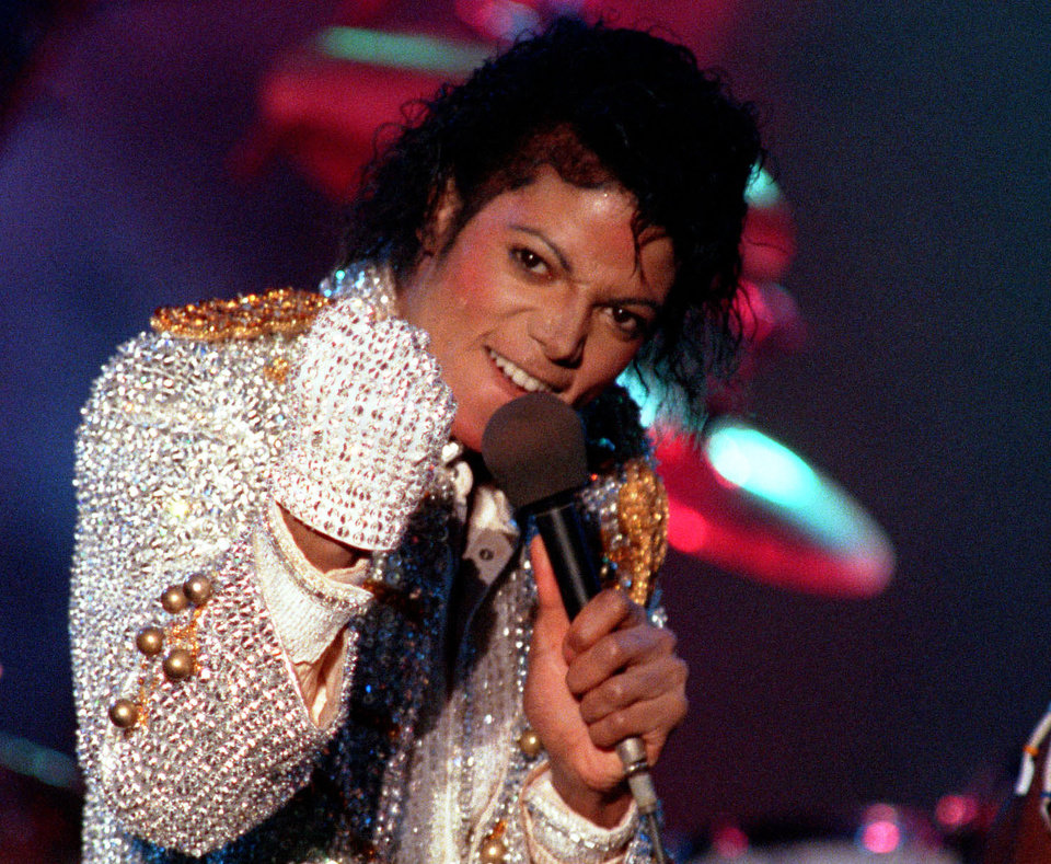 Photo - FILE - In this Dec. 3, 1984 photo, Michael Jackson performs with his brothers at Dodger Stadium in Los Angeles, as part of their Victory Tour concert. Jackson's earning potential may become an issue when a Los Angeles jury begins deliberating a negligent hiring lawsuit filed by the singer's mother, Katherine Jackson, against concert giant AEG Live LLC over her son's 2009 death. Witnesses have testified throughout the 21-week trial that the pop superstar was planning a new career in movies after completing his
