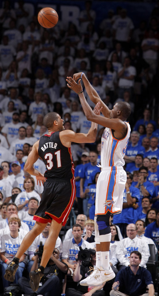 Oklahoma City\'s Kevin Durant (35) shoots a three-pointer over Shane Battier (31) during Game 2 of the NBA Finals between the Oklahoma City Thunder and the Miami Heat at Chesapeake Energy Arena in Oklahoma City, Thursday, June 14, 2012. Photo by Sarah Phipps, The Oklahoman