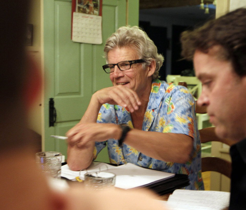Photo -   In this photo taken Sunday Aug. 21, 2011 Academy Award winner Ernest Thompson goes over the script with his cast in New Hampton, N.H. Thirty years after the academy award winning movie,