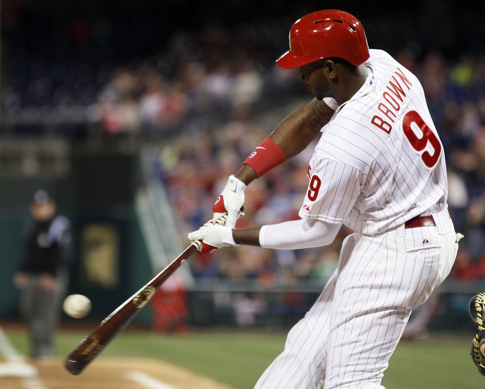 Photo - Philadelphia Phillies' Domonic Brown connects for a single to load the bases  during the fifth inning of a baseball game against the Miami Marlins, Friday, April 11, 2014, in Philadelphia. (AP Photo/Tom Mihalek)