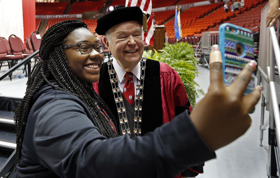 Photo - University of Oklahoma (OU) president David Boren poses with Oklahoma City freshman Jayde Williams following New Sooner Convocation on Thursday, Aug. 20, 2015 in Norman, Okla.  Photo by Steve Sisney, The Oklahoman