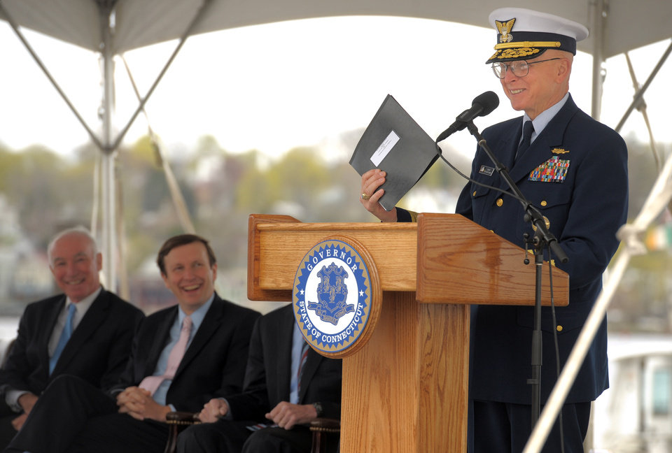 Photo - Admiral Robert J. Papp, Jr., Commandant of the United States Coast Guard holds up the deed to the waterfront property slated for the future National Coast Guard Museum during his comments at the ground breaking ceremony for the museum at the City Pier Stage on Waterfront Park in New London, Conn, Friday May 2, 2014. (AP Photo/The Day, Tim Cook)
