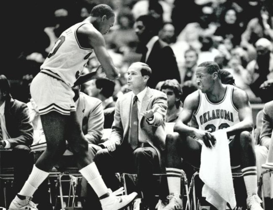 Photo -  BASKETBALL COLLEGE OU 1985: UNKNOWN: Caption reads, Coach Billy Tubbs gives Darryl Kennedy five as Wayman Tisdale (right) enjoys the interplay. Staff Photo by Doug Hoke. Original Photo 0 6/1985. Published on 0-1-27-85.