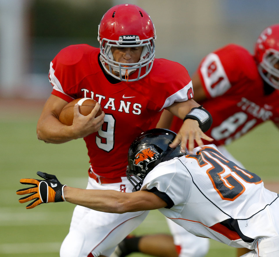 Carl Albert\'s Caleb Toney tries to get past Coweta\'s Adam Price during a high school football game at Carl Albert in Midwest City, Friday, September 7, 2012. Photo by Bryan Terry, The Oklahoman