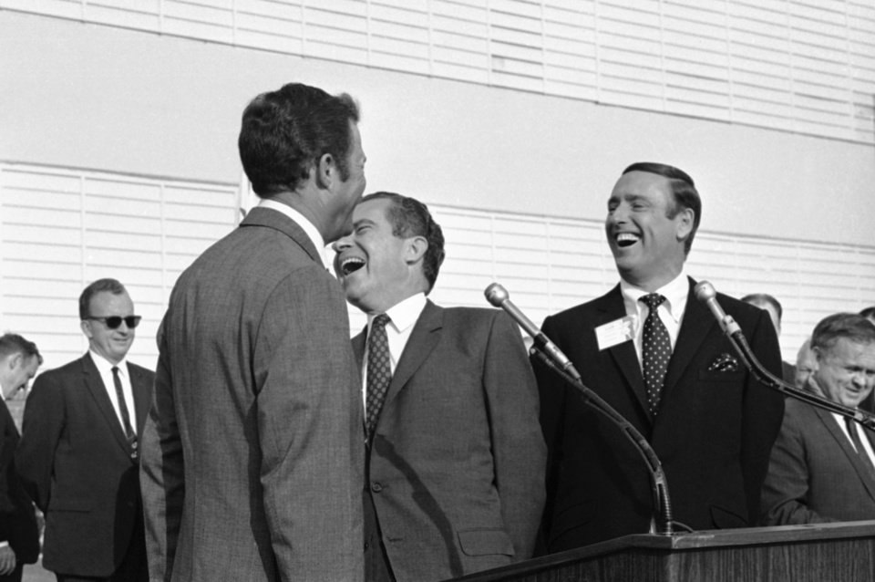 Photo -   FILE - In this Oct. 10, 1968, file photo Republican presidential candidate Richard Nixon, center, laughs at something comedian Dick Martin, right, says, during a rally in Burbank, Calif., Oct. 10, 1968. Some decidedly unfunny candidates have benefited by exceeding extremely low expectations when it comes to jokes. When Nixon went on the TV comedy show