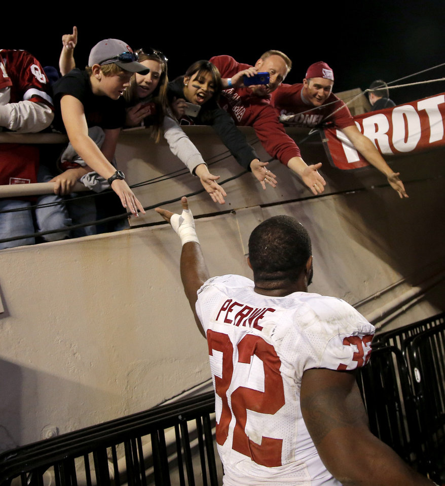 Photo - Oklahoma's Samaje Perine (32) slaps hands with fans after a college football game between the University of Oklahoma Sooners (OU) and the Texas Tech Red Raiders at Jones AT&T Stadium in Lubbock, Texas, Saturday, November 15, 2014.  Photo by Bryan Terry, The Oklahoman
