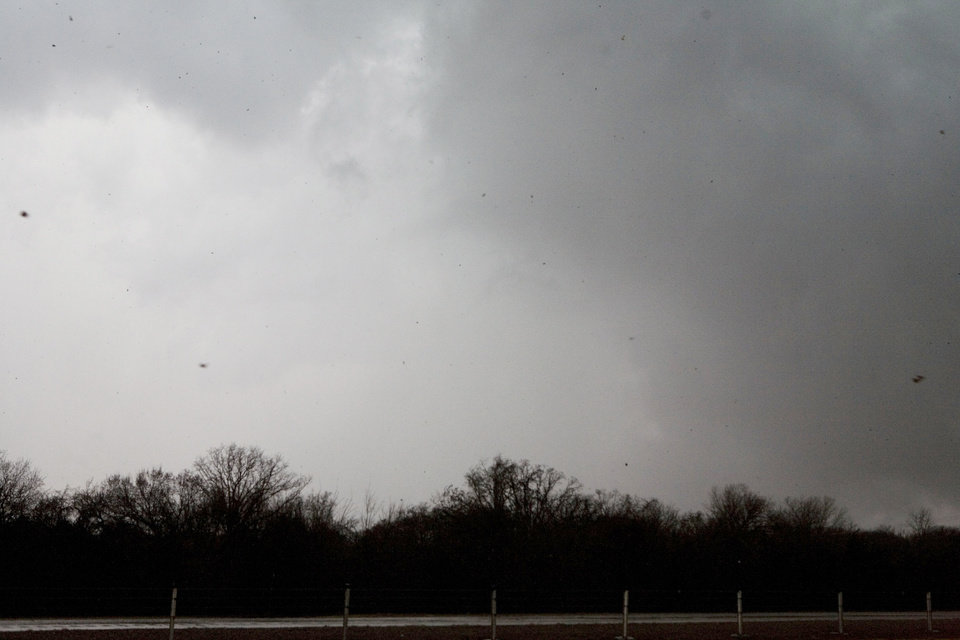 Photo - Looking west from I-35 and Waterloo Rd at the debri falling from a tornado that hit Edmond in the area of Broadway and Waterloo Tuesday Feb. 10. 2009. BY STEVEN MAUPIN, THE OKLAHOMAN.