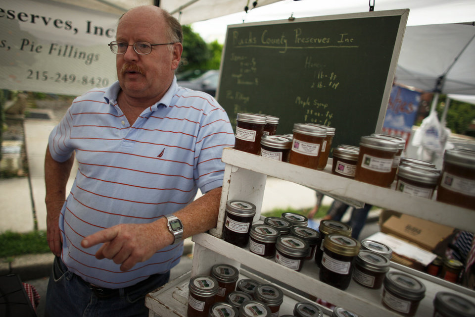 Photo -   Jerry Krone, owner of Bucks County Preserves, talks with a customer at the farmers market, Saturday Oct. 6, 2012, in Doylestown Pa. When the recession cost Jerry Krone his longtime accounting job several years ago, he turned to his hobby, making gourmet jam in his Fountainville kitchen. Krone says neither President Barack Obama nor Mitt Romney truly understands what average families are going through. A registered Republican, Krone voted for Obama in 2008. (AP Photo/ Joseph Kaczmarek)