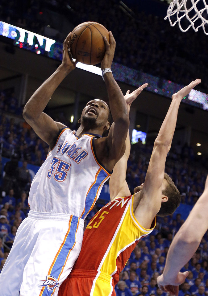Photo - Oklahoma City's Kevin Durant (35) shoots as Houston's Chandler Parsons (25) defends during Game 5  in the first round of the NBA playoffs between the Oklahoma City Thunder and the Houston Rockets at Chesapeake Energy Arena in Oklahoma City, Wednesday, May 1, 2013. Photo by Sarah Phipps, The Oklahoman